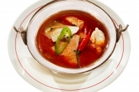 Fish soup á la Szeged with carp fillet and with carp offal served in stewing pot -